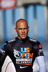 HUNTINGTON BEACH, California/USA (Friday,Aug 5, 2011) 10-Time ASP World Champion Kelly Slater (Cocoa Beach, FL), 39, runs back to the athlete's compound after finsihing his heat friday morning at the U.S. Open of Surfing 2011. Photo: Eduardo E. Silva.