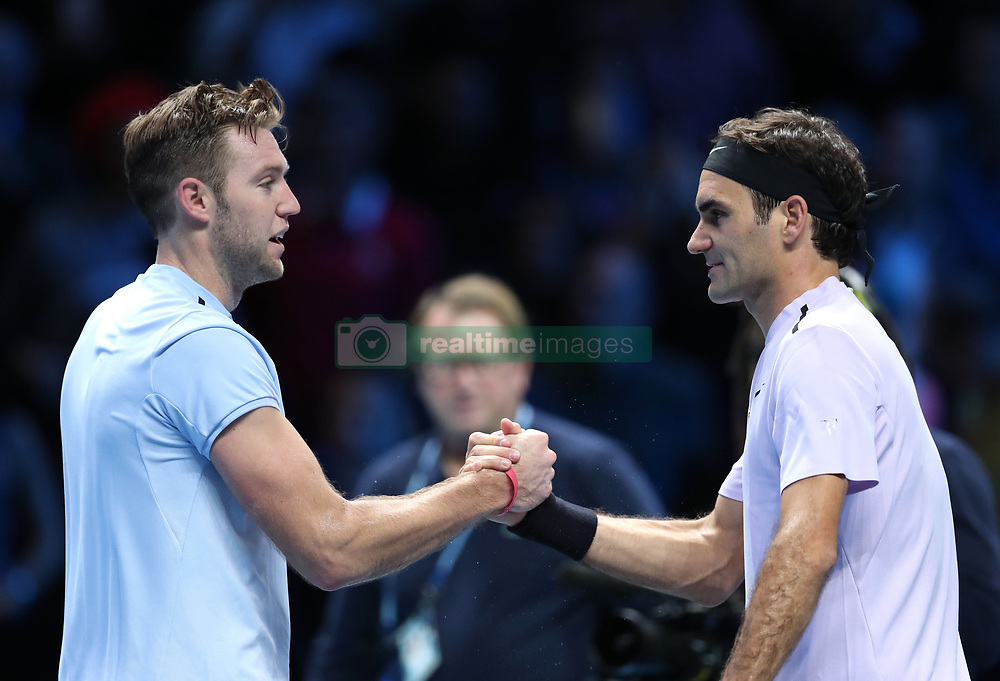 Roger Federer celebrates beating Jack Sock (left) during day one of the NITTO ATP World Tour Finals at the O2 Arena, London.