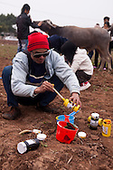 An artist prepares some paints at the Buffalo Painting Festival near Phu Ly, Vietnam.