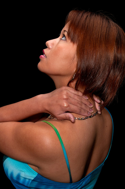 Young woman massaging herself because of a neck and back pain.
