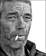Portrait of a rugged weather worn man. Shrimp fishing - the world's last remaining horseback fishermen. Oostduinkerke, Belgium.