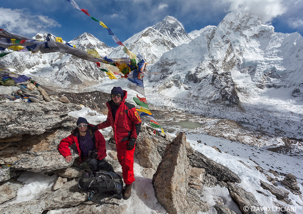 Cécile and André standing on the top of Kala Pattar. With Khumbutse (6636m), Changtse (7543m), Everest West Shoulder, Everest (8850m), Lhotse (8516m) and Nuptse (7861m) in the background.