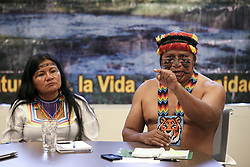 April 16, 2018 - Toronto, ON, Canada - TORONTO, ON - APRIL 16  -  Rafael Pandan (R), from the Achuar Nation, and President of the Indigenous Amazonian Parliament of Ecuador, speaks during media availability in Toronto, while Ecuadorian leader, Janeth Cuji, from the Kichwa Nation, listens at left, April 16, 2018. The indigenous people from Ecuador are suing Chevron for polluting their homeland for decades. This week an Ontario judge will hear arguments to decide if Chevron's Canadian assets are at risk. Andrew Francis Wallace/Toronto Star (Credit Image: © Andrew Francis Wallace/The Toronto Star via ZUMA Wire)