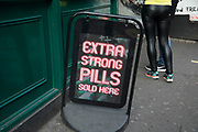 Extra strong pills for sale at an adult sex shop in Soho, central London, United Kingdom. Here there were once sex shops, DVD shops, live sex shows and all manner of pornographic offerings, but now it is all but closed and being redeveloped and gentrification continues. Viagra and Cialis advertised here, are both prescription drugs to counteract erectile disfunction, they are also widely available on the net as well as in sex shops.