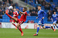 Ryan Shotton of Birmingham city (l) gets to the ball ahead of Anthony Pilkington of Cardiff city.. EFL Skybet championship match, Cardiff city v Birmingham City at the Cardiff City Stadium in Cardiff, South Wales on Saturday 11th March 2017.<br /> pic by Andrew Orchard, Andrew Orchard sports photography.