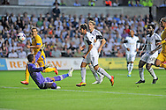 Swansea city's Alejandro Pozuelo scores his sides 5th goal.<br /> UEFA Europa league, play off round, 1st leg match, Swansea city v FC Petrolul Ploiesti at the Liberty stadium in Swansea on Thursday 22nd August 2013. pic by Phil Rees , Andrew Orchard sports photography,