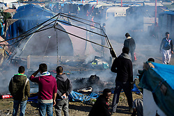 © Licensed to London News Pictures. 25/10/2016. Calais, France.  Remains of a burnt out living tent which was set on fire at the migrant and refugee camp in Calais, known as the 'Jungle'. French authorities have moved thousands of refugees and migrants living at the makeshift living area on the French coast, with some still refusing to leave. . Photo credit: Ben Cawthra/LNP