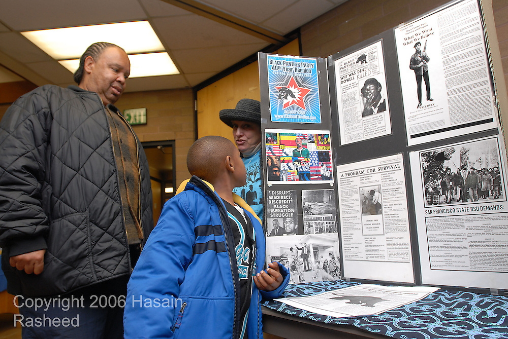 Hasain Rasheed 4/15/06 Tribune.David Woolridge who attended the Black Panther Party free breakfast programs as a youth, brought his seven-year-old son, Rayshaun to Bobby Hutton Day at the West Oakland Library, Saturday.