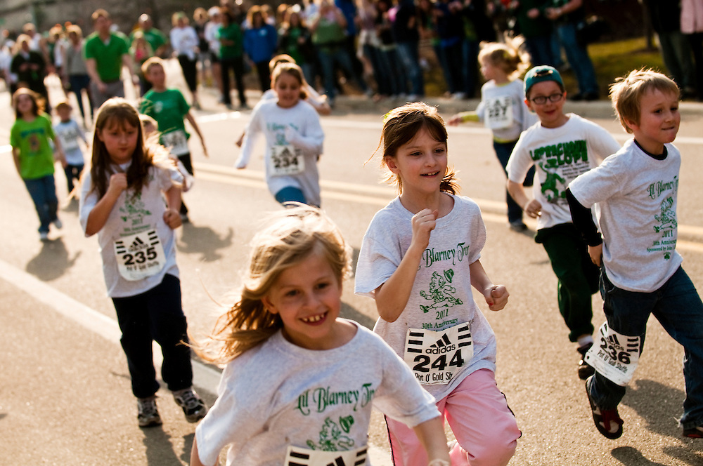 Matt Dixon   The Flint Journal..Kids compete in the Little Blarney Trot, a quarter mile road race on Kearsley Road in downtown Flint, Thursday, March 17. The race was held before the larger, 4 mile, 30th Pot O'Gold Road Race. Both races were hosted by the Ancient Order of Hibernians.