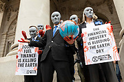A group of faceless financiers from the climate activist group Extinction Rebellion hold up hands soaked in fake blood and placards protesting fossil fuel usage on the steps of the Bank of England on 27th August, 2021 in London, United Kingdom. The activist group Extinction Rebellion XR are planning actions of disruption for two weeks straight beginning on August 23rd, 2021 in an effort to bring awareness and priority to the global climate emergency in advance of the COP 26 Summit which will be held in Glasgow later this year.