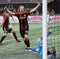 March 11, 2018 - Atlanta, GA, USA - Atlanta United midfielder Jeff Larentowiz reacts as a shot by teammate Hector Villalba gets past D.C. United goalkeeper David Ousted for a 3-0 lead during the second half on Sunday, March 11, 2018, in Atlanta, Ga. Atlanta United won the game 3-1. (Credit Image: © Curtis Compton/TNS via ZUMA Wire)