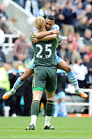 Football - Premier League -  Newcastle United vs. Manchester City<br /> Joe Hart (Manchester City) celebrates with Gael Clichy (Manchester City) at the end of the game at St James' Park.