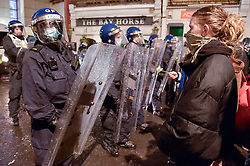 """© Licensed to London News Pictures;26/03/2021; Bristol, UK. Police and demonstrators have a stand off at Bridewell Police station at a third """"Kill the Bill"""" protest in Bristol this week takes place against the Police, Crime, Sentencing and Courts Bill during the Covid-19 coronavirus pandemic in England. The Bill proposes new restrictions on protests. Lockdown restrictions have been partly lifted to allow people to gather outdoors socially in households, bubbles, or to meet one person from another household, but the police say protests are not allowed under the current Covid regulations. Photo credit: Simon Chapman/LNP."""