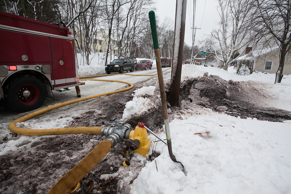 Hingham, MA 02/11/2013.Hingham Fire Chief Mark Duff said the closest hydrant to the scene was buried in snow and had to be dug out, slowing progress in the initial fire attack..Alex Jones / www.alexjonesphoto.com