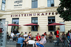 Busy Einstein Cafe at Checkpoint Charlie in Berlin Germany