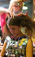 9/19/09 Omaha NE.Abby Uecker gets her hair worked on at the Nomad Lounge as part of Omaha Fashion Week 2009..(Chris Machian/Omaha World-Herald)