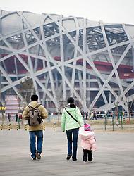 Family with single child walking towards Bird`s Nest Olympic Stadium in Beijing 2009