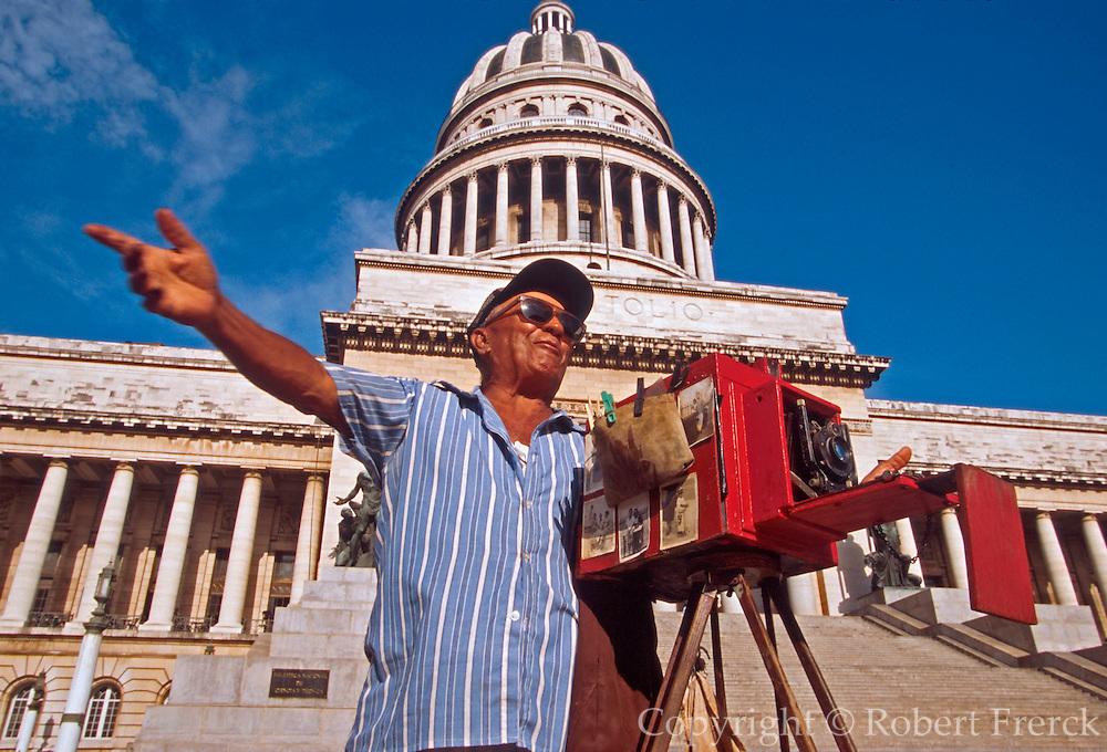 CUBA, HAVANA (CENTRO HABANA) Capitolio Nacional, modeled after the U.S. Capitol Building and street  photographer with antique camera