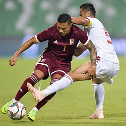 Omid Ebrahimi (R) of Iran vies for the ball with Darwin Machis (L) of Venezuela during the international friendly soccer match between Iran and Venezuela at Al Ahli Stadium Doha, Capital of Qatar, November 20, 2018. The match ended with a 1-1 draw. (Credit Image: © Nikku/Xinhua via ZUMA Wire)