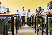 VSO volunteer Paul Jennings and local teacher Rebecca  Ngovano wait to begin their training session. Paul has been working with Rebecca for over 6 months to improve teaching methodologies in classrooms. Angaza school, Lindi, Tanzania