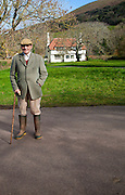 Smartly dressed gentleman out for his morning walk in Bossington, Exmoor national park, Somerset, England