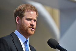 The Duke of Sussex speaks during a garden party at Buckingham Palace in London which he is attending as his first royal engagement following his marriage to the Duchess of Sussex.