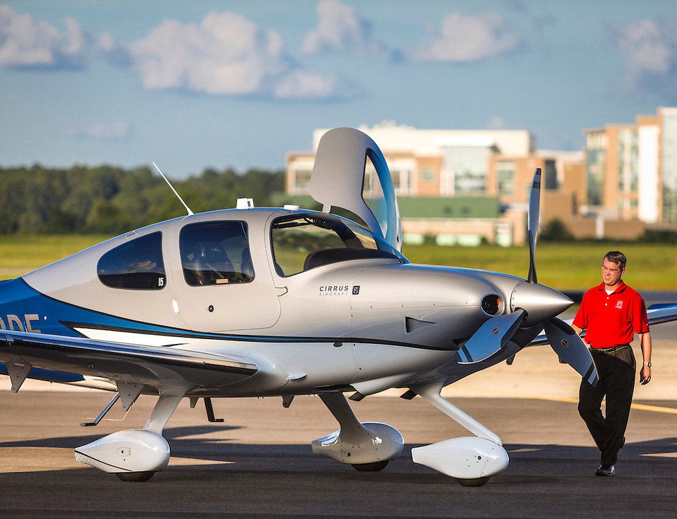 A pilot conducts a pre-flight inspection of a Cirrus Vision Inspired SR22T on the ramp at Atlanta's DeKalb Peachtree Airport (PDK).