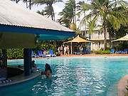 Relaxing by the pool at Daydream Island Resort; Whitsunday Islands, QLD, Australia.