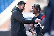 Leeds United U23's manager Carlos Corberan greets Crystal Palace U23's manager Richard Shaw during the U23 Professional Development League match between U23 Crystal Palace and Leeds United at Selhurst Park, London, England on 15 April 2019.