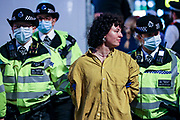 A member of the Extinction Rebellion is taken away by police at Cambridge Circus, in central London on Tuesday, Aug 24, 2021.  XR is in an ongoing two-week protest campaign to demand that the government take greater action to address climate change. (VX Photo/ Vudi Xhymshiti)