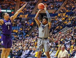 Jan 14, 2020; Morgantown, West Virginia, USA; West Virginia Mountaineers guard Miles McBride (4) shoots a three pointer over TCU Horned Frogs guard Desmond Bane (1) during the second half at WVU Coliseum. Mandatory Credit: Ben Queen-USA TODAY Sports