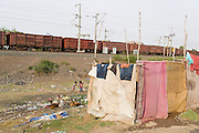 While a train is passing by, two young boys are arguing near piles of garbage and a makeshift toilet set up  along the railway tracks in New Arif Nagar, one of the water-affected colonies standing next to the abandoned Union Carbide (now DOW Chemical) industrial complex, site of the infamous 1984 gas tragedy in Bhopal, Madhya Pradesh, central India. The poisonous cloud that enveloped Bhopal left everlasting consequences that today continue to consume people's lives.