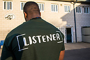 A prisoner wearing a Listener t-shirt in one of  the excercise yards at HMP/YOI Portland, Dorset, United Kingdom.