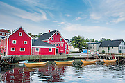 Little rowing boat anchored in the harbour of the old town Lunenburg, Unesco world heritage sight, Nova Scotia, Canada, USA