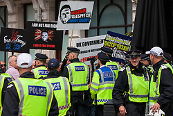 London, UK. 9th June, 2018. Police officers control a group of supporters of Tommy Robinson, former leader of the far-right English Defence League, outside a pub in Parliament Street close to anti-fascists protesting against the March for Tommy Robinson.