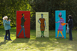 """© Licensed to London News Pictures. 07/10/2020. LONDON, UK. Women view """"Five Conversations"""", 2019, by Lubaina Himid at Frieze Sculpture, an annual exhibition of outdoor works by international artists in Regent's Park.  The works are on display to the public until 18 October.  Photo credit: Stephen Chung/LNP"""