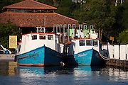 Brightly painted boats at the dock on Ilha do Mel, Brazil