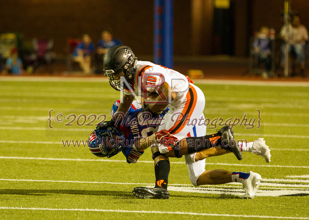 The Norman Tigers, Andrew Young (#10) goes 1-on-1 with the Moore Lions, Braden Sloan (#80).