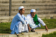 28 JULY 2014 - KHLONG HAE, SONGKHLA, THAILAND:  Men wait for Eid services to start at Songkhla Central Mosque. Eid al-Fitr is also called Feast of Breaking the Fast, the Sugar Feast, Bayram (Bajram), the Sweet Festival and the Lesser Eid, is an important Muslim holiday that marks the end of Ramadan, the Islamic holy month of fasting.  PHOTO BY JACK KURTZ