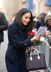 Meghan Markle meets well-wishers as she arrives with Prince Harry at the Nottingham Contemporary in Nottingham, to attend a Terrence Higgins Trust World AIDS Day charity fair on their first official engagement together.