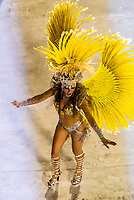 Samba dancer in the Carnaval parade of Unidos da Ponte samba school in the Sambadrome, Rio de Janeiro, Brazil.