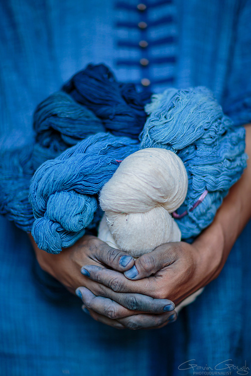 A man holding balls of yarn dyed with indigo using traditional dyeing methods, Indigo Dyeing Factory, Sakhon Nokhon, Thailand