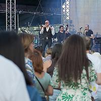 Italian singer Mario Biondi (C) performs on the main stage at the Paloznak Jazz Picnic music festival held in Paloznak, Hungary on July 29, 2021. ATTILA VOLGYI