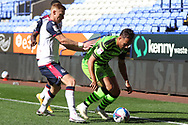 Forest Green Rovers Kane Wilson tackled by Bolton Wanderers Eoin Doyle during the EFL Sky Bet League 2 match between Bolton Wanderers and Forest Green Rovers at the University of  Bolton Stadium, Bolton, England on 12 September 2020.