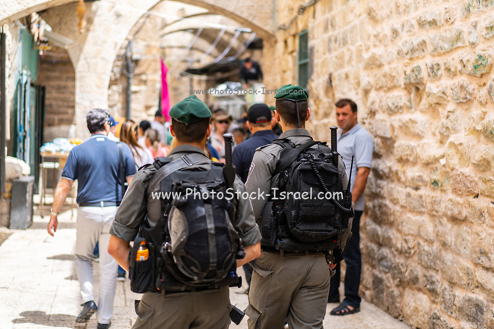 Israeli Border police soldiers patrol an Alley in the Old City, Jerusalem, Israel