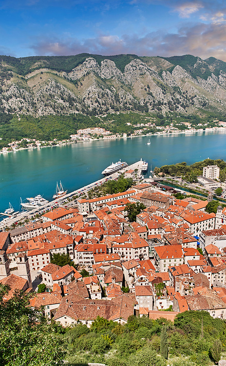 Scenic view from above of Kotor Town and Kotor Bay from Kotor mountain, Montenegro . The old Mediterranean port of Kotor is surrounded by fortifications built during the Venetian period. It is located on the Bay of Kotor (Boka Kotorska), one of the most indented parts of the Adriatic Sea. Some have called it the southernmost fjord in Europe, but it is a ria, a submerged river canyon. .<br /> <br /> Visit our MONTENEGRO HISTORIC PLAXES PHOTO COLLECTIONS for more   photos  to download or buy as prints https://funkystock.photoshelter.com/gallery-collection/Pictures-Images-of-Montenegro-Photos-of-Montenegros-Historic-Landmark-Sites/C0000AG8SdQ.sYLU