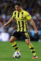 MADRID, SPAIN - APRIL 30:  Robert Lewandowski of Borussia Dortmund in action during the UEFA Champions League semi-final second leg match between Real Madrid and Borussia Dortmund at Estadio Santiago Bernabeu on April 30, 2013 in Madrid, Spain. (Photo by Manuel Queimadelos)
