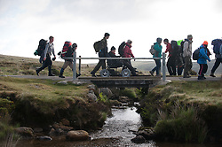 © licensed to London News Pictures. Okehampton, UK  14/05/2011 A group crosses a stream as they take part in the Jubilee Challenge, where nearly 300 less able bodied youngsters complete a 15 mile trek over Dartmoor. Please see special instructions for usage rates. Photo credit should read London News Pictures