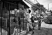 Basqueteball is the main sport in Philippines, within the cemetery children play in a cleaner area where family of the dead have some money to maintain graves with more dignity.