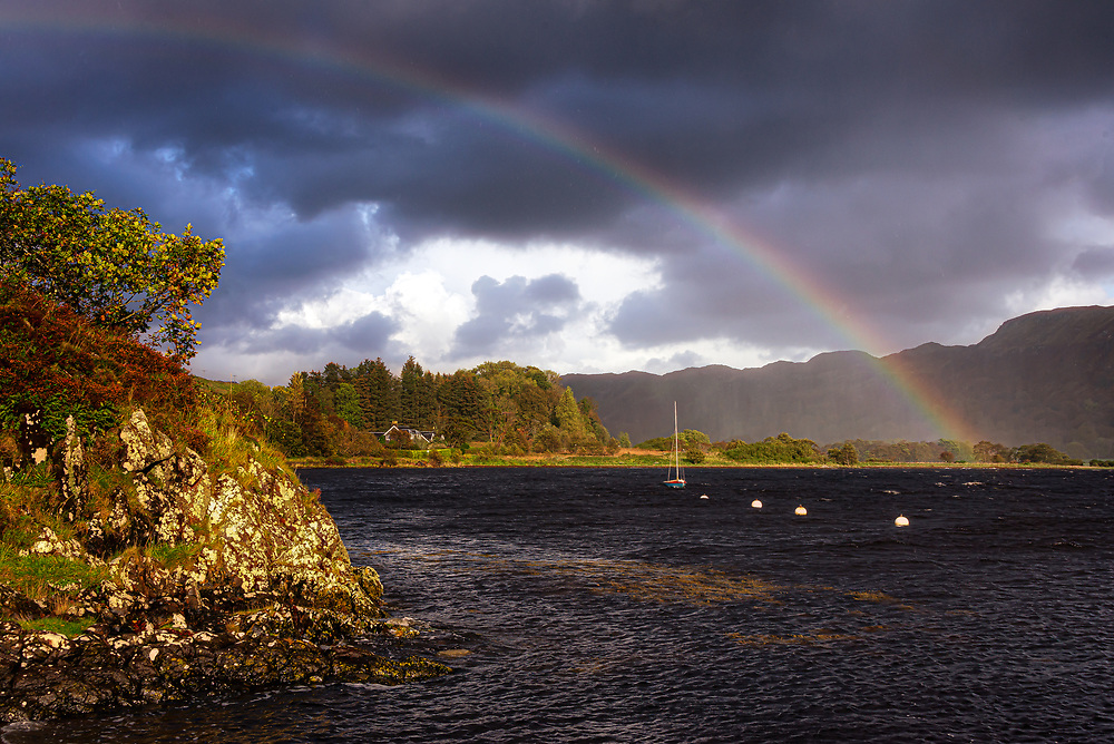 Low sun and fast-moving broken cloud combined with scattered rain showers produce frequent rainbows.